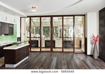Modern Drawing Room (studio) And Kitchen Interior With Balcony And Dark Wooden Floor