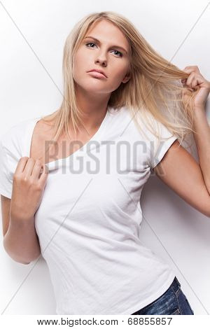 Young beautiful fashion model in white t-shirt.