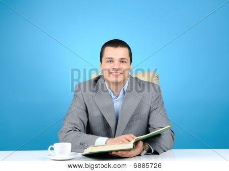 Cheerful businessman on blue
