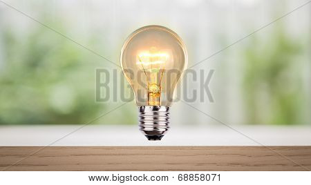 Bulb on wood shelf