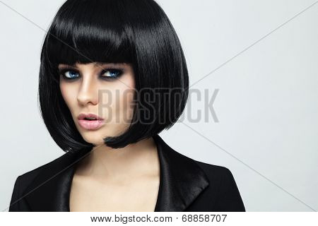 Young beautiful sexy woman with stylish bob haircut and smoky eyes