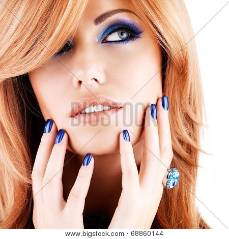 portrait of a beautiful woman with blue nails, blue makeup and  long red hairs  on white  background