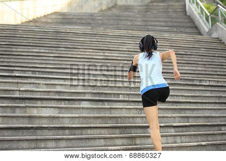 Runner athlete running on stairs