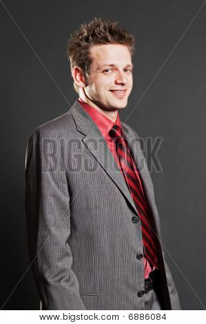 Smiley Businessman In Grey Suit