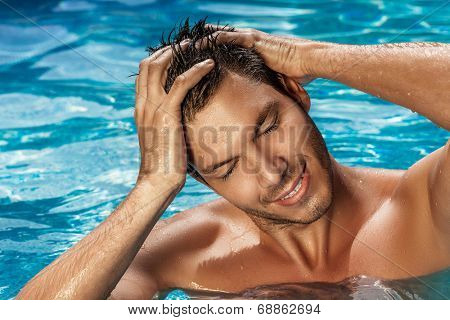 man bathing washing swimming in tropical spa resort