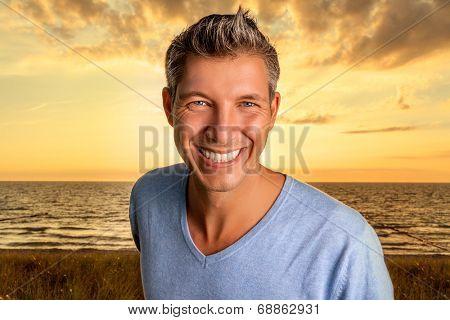 male portrait on dune coast seaside