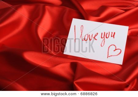 "Note On Red Silk. With An Inscription "" I Love You "" And Heart. Drawn By Lipstick"