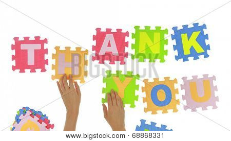 "Hands forming words ""Thank you"" with jigsaw puzzle pieces isolated"