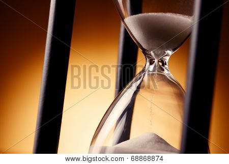 Sand Running Through An Egg Timer Or Hourglass