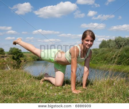 Sporty Girl Exercising Against River