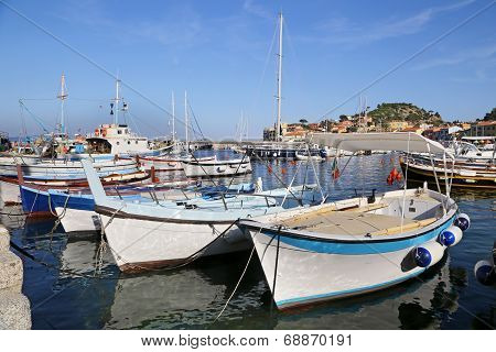 Boats In The Small Harbor Of Giglio Island