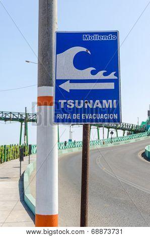 MOLLENDO, PERU, MAY 20, 2014 - Sign showing evacuation route in case of tsunami