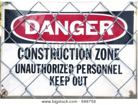 DANGER, CONSTRUCTION ZONE, Unauthorized Personnel Keep Out - sign behind