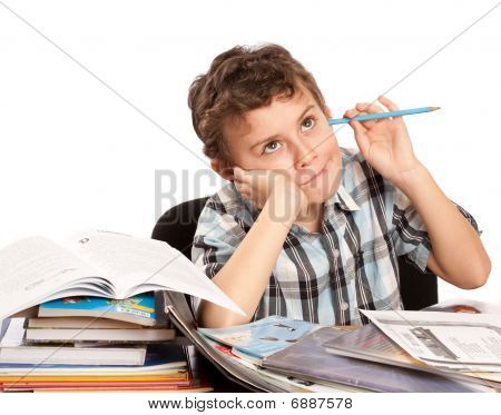 Schoolboy Reluctant To Doing Homework