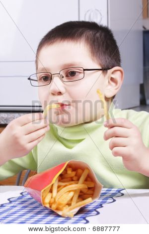 Boy Eating Fried Potato
