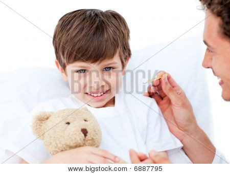 Joyful Doctor Taking Little Boy's Temperature