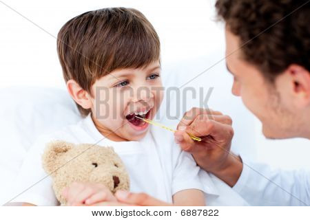 Positive Doctor Taking Little Boy's Temperature