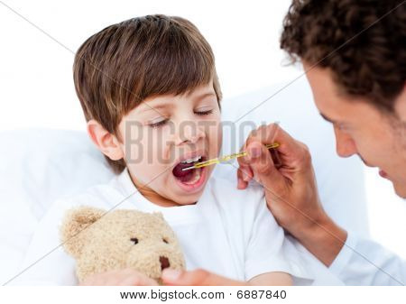 Doctor Taking Little Boy's Temperature