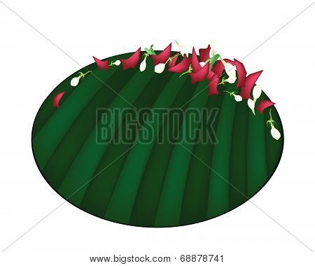 Corolla Of Roses And Jasmines On Banana Leaf