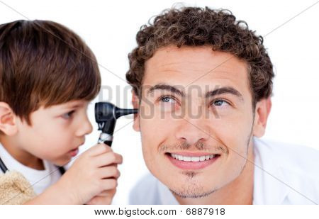 Little Boy Playing With The Doctor