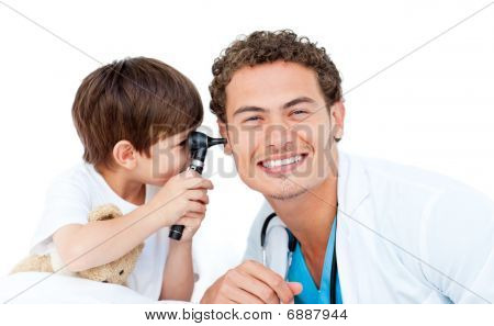 Little Boy Checking Doctor's Ears