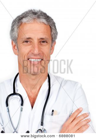 Mature Doctor Carrying A Stethoscope