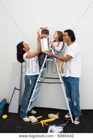 Happy Family Painting A Room