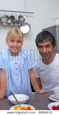 Blond Little Girl And Her Father Having Breakfast