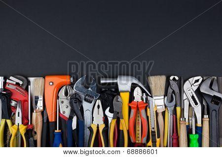 Work tools on black background.