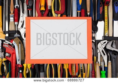 Decorative white page on background of lined up work tools.