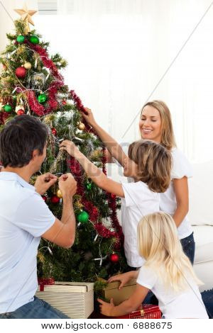 Joyful Family Decorating Christmas Tree