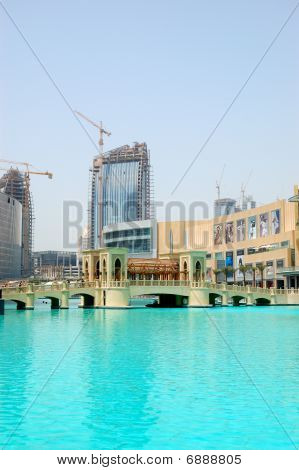 Dubai - August 27: The Bridge Over Man-made Lake In Dubai Downtown.  It Is Located In Burj Khalifa C