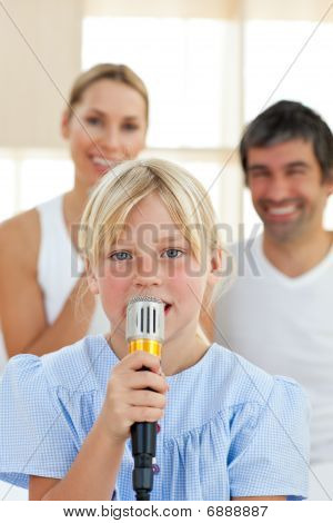 Adorable Little Girl Singing With A Microphone