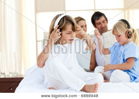 Jolly Siblings Listening Music With Headphones