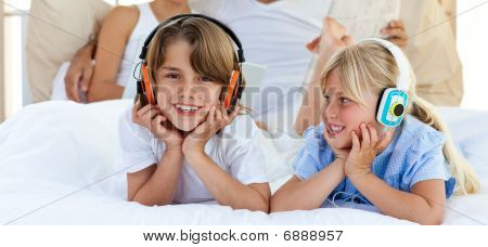 Close-up Of Brother And Sister Listening Music