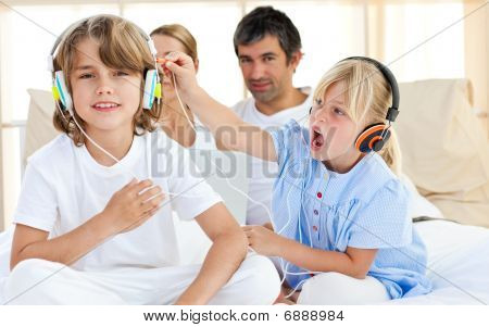 Merry Children Having Fun And Listening Music