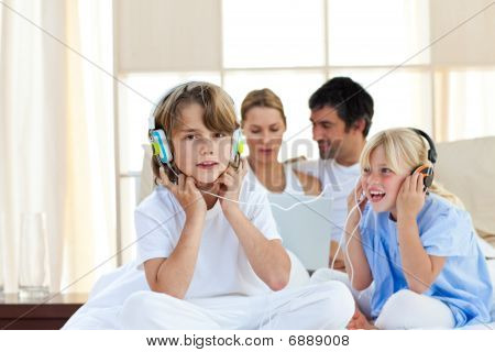 Animated Children Having Fun And Listening Music