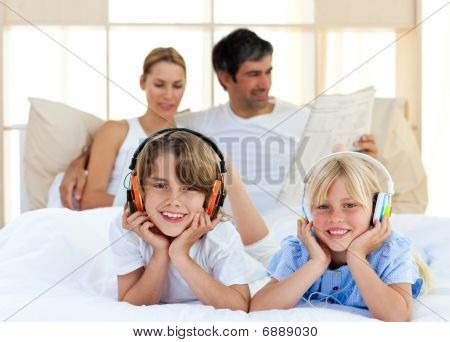 Cute Siblings Listening Music With Headphones