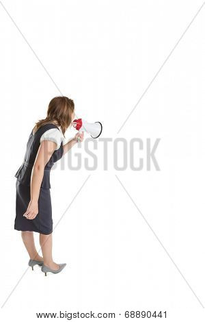 Young businesswoman shouting into bullhorn over white background