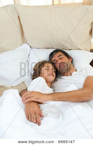 Father And Son Sleeping Together | Stock photo
