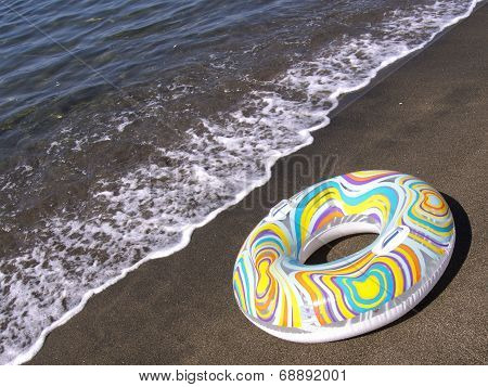 Inflatable Donut On The Seashore
