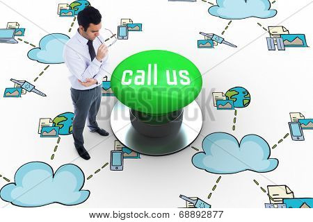 The word call us and unsmiling businessman holding glasses against digitally generated green push button