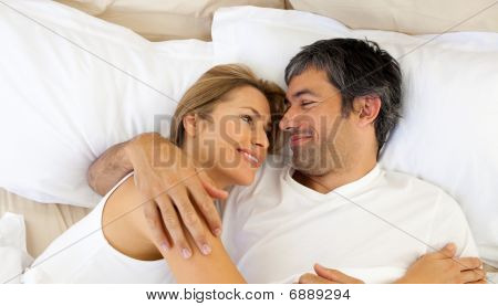 Affectionate Couple Hugging Lying In Bed