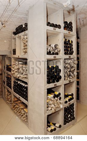 Wine cellar with old riesling wine, labels are blurred or modified