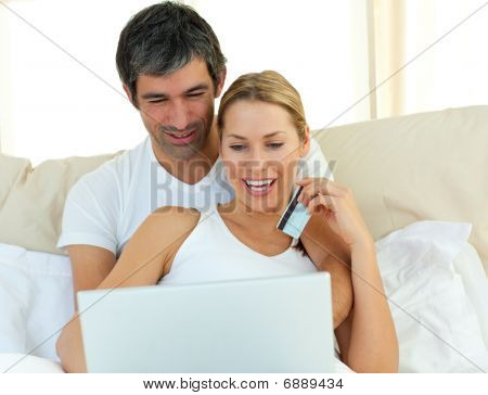 Jolly Couple Buying On Internet