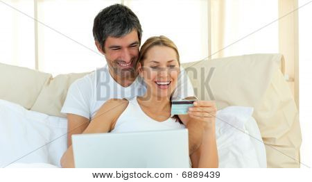 Affectionate Couple Buying On Internet