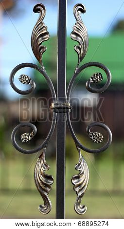 Exquisite Forged Bronze Fence Element Over Defocused Background