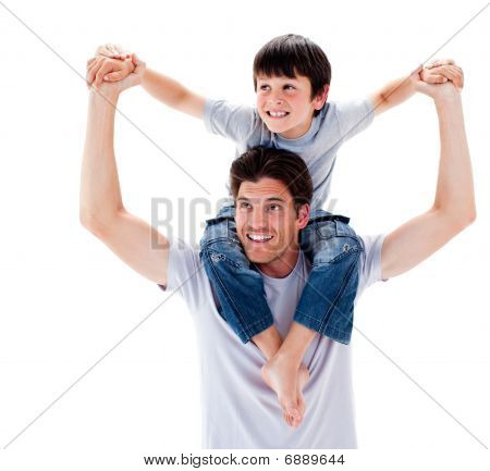 Close-up Of Father Giving His Son Piggyback Ride