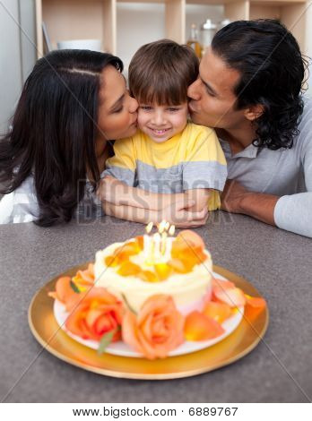Affectionate Parents Celebrating Their Son's Birthday