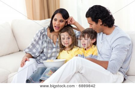 Jollyfamily Watching Tv On Sofa